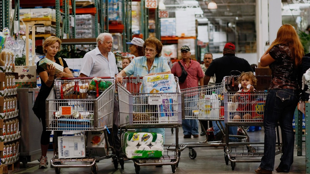 NORTH MIAMI - MARCH 13: Michael Kaire (2nd L) and Sylvia Kaire (C) and others shop at a Costco store March 13, 2008 in North Miami, Florida.The Commerce Department released a report today that shows retail sales fell by 0.6 percent last month. Costco has shown strong quarterly results as most of the U.S. market flounders. (Photo by Joe Raedle/Getty Images) *** Local Caption *** Michael Kaire, Sylvia Kaire